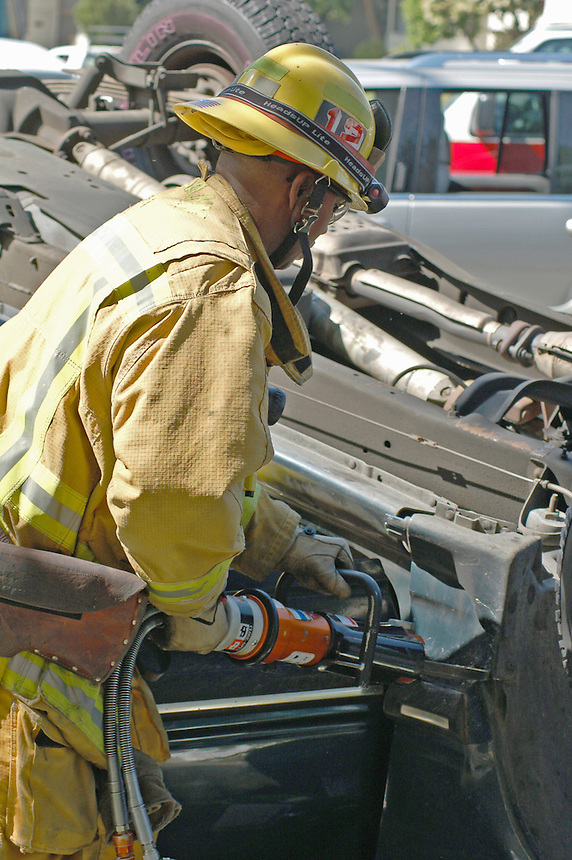 Burbank Firefighter using rescue tool   Chester Brown