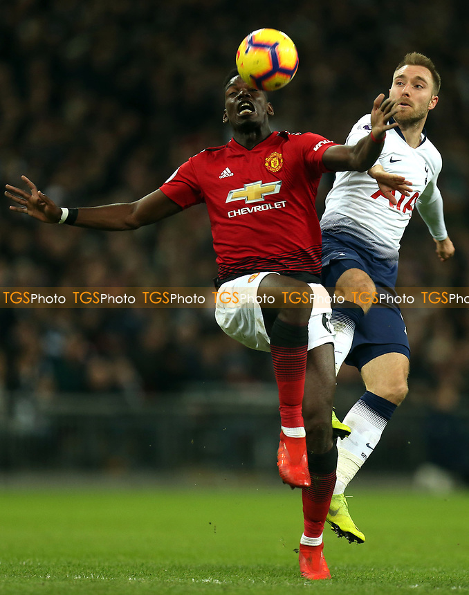 Christian Eriksen of Tottenham Hotspur and Paul Pogba of Manchester United during Tottenham Hotspur vs Manchester United, Premier League Football at Wembley Stadium on 13th January 2019