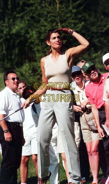 CINDY CRAWFORD .At The Pro-Celeb Golf Open In Crans-Montana, Switzerland.Ref: MAX.golf, sport, sleeveless, tee, looking for ball,full length, full-length.www.capitalpictures.com.sales@capitalpictures.com.© Capital Pictures