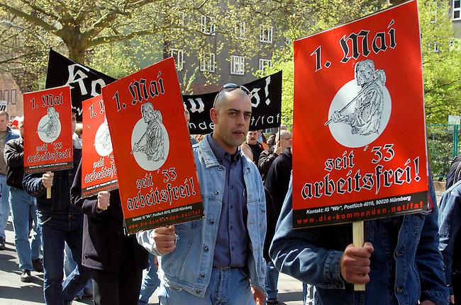 NPD-Demonstration zum 1. Mai in Berlin<br /> Etwa 1.200 Anhaenger und Sympathiesanten der rechtsextremen NPD versammelten sich zu Demonstration unter dem Motto: &quot;Wir sind das Volk&quot; in Berlin Charlottenburg. Abgeschirmt durch ein grosses Polizeiaufgebot zog die Demonstration zum Olympiastadium.<br /> Hier: Rechtsextremisten mit Plakaten &quot;1.Mai - seit 33 arbeitsfrei&quot;.<br /> 1.5.2003, Berlin<br /> Copyright: Christian-Ditsch.de<br /> [Inhaltsveraendernde Manipulation des Fotos nur nach ausdruecklicher Genehmigung des Fotografen. Vereinbarungen ueber Abtretung von Persoenlichkeitsrechten/Model Release der abgebildeten Person/Personen liegen nicht vor. NO MODEL RELEASE! Nur fuer Redaktionelle Zwecke. Don't publish without copyright Christian-Ditsch.de, Veroeffentlichung nur mit Fotografennennung, sowie gegen Honorar, MwSt. und Beleg. Konto: I N G - D i B a, IBAN DE58500105175400192269, BIC INGDDEFFXXX, Kontakt: post@christian-ditsch.de<br /> Bei der Bearbeitung der Dateiinformationen darf die Urheberkennzeichnung in den EXIF- und  IPTC-Daten nicht entfernt werden, diese sind in digitalen Medien nach &sect;95c UrhG rechtlich geschuetzt. Der Urhebervermerk wird gemaess &sect;13 UrhG verlangt.]