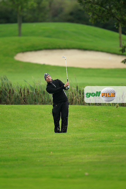 Michael McDermott (Pure Golf Leopardstown) on the 18th during Round 3 of The Cassidy Golf 103rd Irish PGA Championship in Roganstown Golf Club on Saturday 12th October 2013.<br /> Picture:  Thos Caffrey / www.golffile.ie
