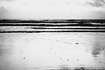 black white photo of ocean shore and tides