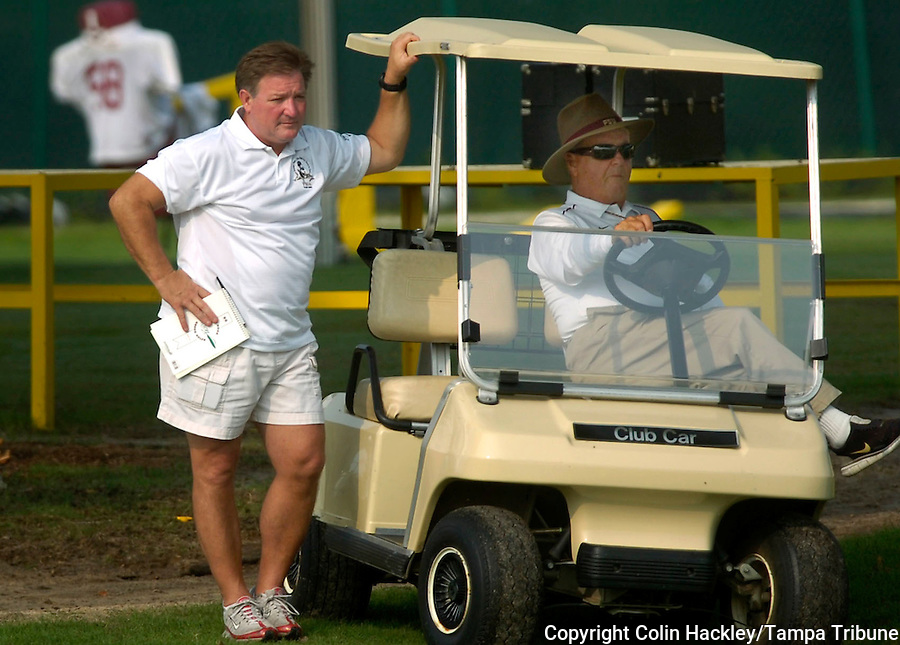 TALLAHASSEE, FL. 8/7/07-Florida State Coach Bobby Bowden, right, is joined by his son Terry during the Seminole's first practice Tuesday in Tallahassee. Terry Bowden, who coached at Auburn from 1993-98, is observing Florida State's program this year in preparation for a possible return to a coaching career in 2008. COLIN HACKLEY PHOTO