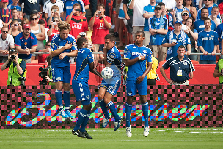 """July 25, 2010         Wizards playes formed a wall to block a shot on goal in the first half.   The Kansas City Wizards of Major League Soccer defeated Manchester United of the English Premier League 2-1 in an international friendly game on Sunday July 25, 2010 at Arrowhead Stadium in Kansas City, Missouri.  The game is the third of four stops for Manchester United on their """"Tour 2010""""."""