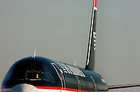 A US Airways pilot waits for the go ahead to take off at Charlotte-Douglas International Airport in Charlotte, North Carolina. Charlotte-based photographer has other images of transportation, airplanes on runways (and taking off and landing) and interior/exterior airport images of Charlotte-Douglas Intl Airport in portfolio.