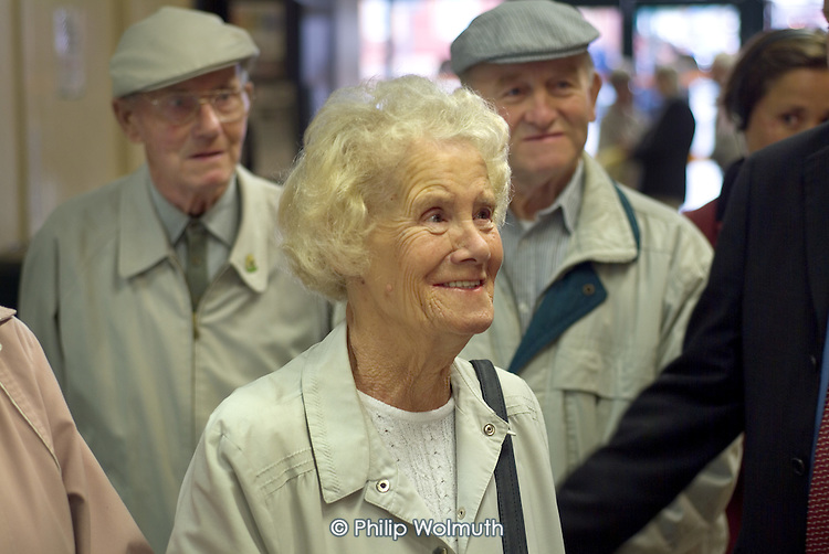 Elderly shoppers listen to a local candidate during a by-election campaign in Hartlepool.