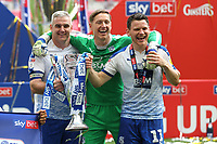 Steve McNulty, Scott Davies and Connor Jennings celebrate promotion to Division One with the Play-Off Trophy during Newport County vs Tranmere Rovers, Sky Bet EFL League 2 Play-Off Final Football at Wembley Stadium on 25th May 2019