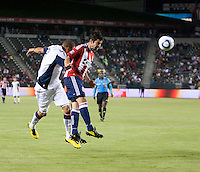 Chivas midfielder Paulo Nagamura (26) heads ball from Revolution midfielder Chris Tierney (8) during the second half of the game between Chivas USA and the New England Revolution at the Home Depot Center in Carson, CA, on September 10, 2010. Chivas USA 2, New England Revolution 0.