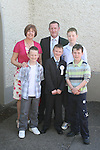 Brian Reilly with his family at the Walshestown NS Communion in St.Pauls Church...Photo NEWSFILE/Jenny Matthews.(Photo credit should read Jenny Matthews/NEWSFILE)....This Picture has been sent you under the condtions enclosed by:.Newsfile Ltd..The Studio,.Millmount Abbey,.Drogheda,.Co Meath..Ireland..Tel: +353(0)41-9871240.Fax: +353(0)41-9871260.GSM: +353(0)86-2500958.email: pictures@newsfile.ie.www.newsfile.ie.FTP: 193.120.102.198.