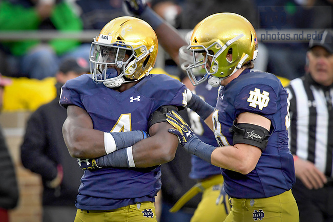 October 28, 2017;  Te'von Coney (4) and Greer Martini (48) celebrate after a sackagainst North Carolina State. (Photo by Matt Cashore)