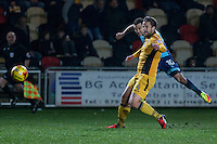 Matthew Bloomfield of Wycombe Wanderers shoots at goal under pressure from Darren Jones of Newport County during the Sky Bet League 2 match between Newport County and Wycombe Wanderers at Rodney Parade, Newport, Wales on 22 November 2016. Photo by Mark  Hawkins.