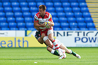 Freddie Burns of Gloucester Rugby is tackled by Tomas O'Leary of London Irish during the Aviva Premiership match between London Irish and Gloucester Rugby at the Madejski Stadium on Saturday 8th September 2012 (Photo by Rob Munro)