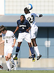 2 September 2007: Monmouth's Damon Wilson (9) challenges Wake Forest's Ike Opara (23) and Sam Cronin (2) for a header. The Wake Forest University Demon Deacons defeated the Monmouth University Hawks 2-0 at Fetzer Field in Chapel Hill, North Carolina in an NCAA Division I Men's Soccer game.