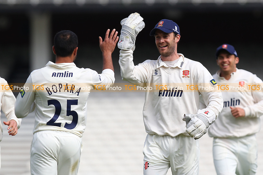 Ravi Bopara of Essex is congratulated by captain James Foster (C) after his throw runs out Rory Burns - Surrey CCC vs Essex CCC - LV County Championship Division Two Cricket at the Kia Oval, Kennington, London - 22/04/14 - MANDATORY CREDIT: Gavin Ellis/TGSPHOTO - Self billing applies where appropriate - 0845 094 6026 - contact@tgsphoto.co.uk - NO UNPAID USE