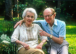 """82 year old radio sportscaster Walter Lanier """"Red"""" Barber with his wife at their home in Tallahassee, Florida August 18, 1990.  Barber passed away two years later.  Barber became an icon broadcasting the play by play for the Brooklyn Dodgers and the New York Yankees professional baseball teams becoming known for this southern catchphrases.  Red Barber's wife's name is Lylah.  In his final years he did a weekly radio show from his home for NPR."""