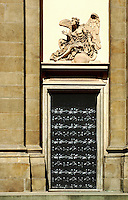 Winged sclupture above a black door. Detail of a church in Cracow, Malopolska, Poland