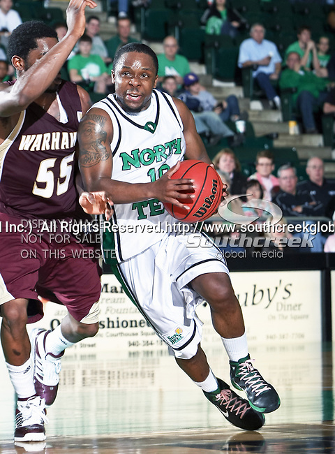 North Texas Mean Green guard Josh White (10) in action during the NCAA  basketball game between the University of Louisiana at Monroe Warhawks and the University of North Texas Mean Green at the North Texas Coliseum,the Super Pit, in Denton, Texas. ULM defeated UNT 82 to 75...