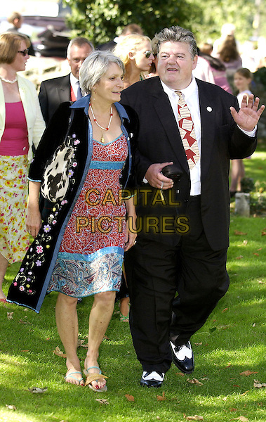 ROBBIE COLTRANE & GUEST.At the wedding of Jools Holland & Christabel McEwen at St. James Church, Cooling,.Kent 30th August 2005.full length black suit gangster shoes red turquoise pattern dress coat hand wedding marraige .www.capitalpictures.com.sales@capitalpictures.com.© Capital Pictures.