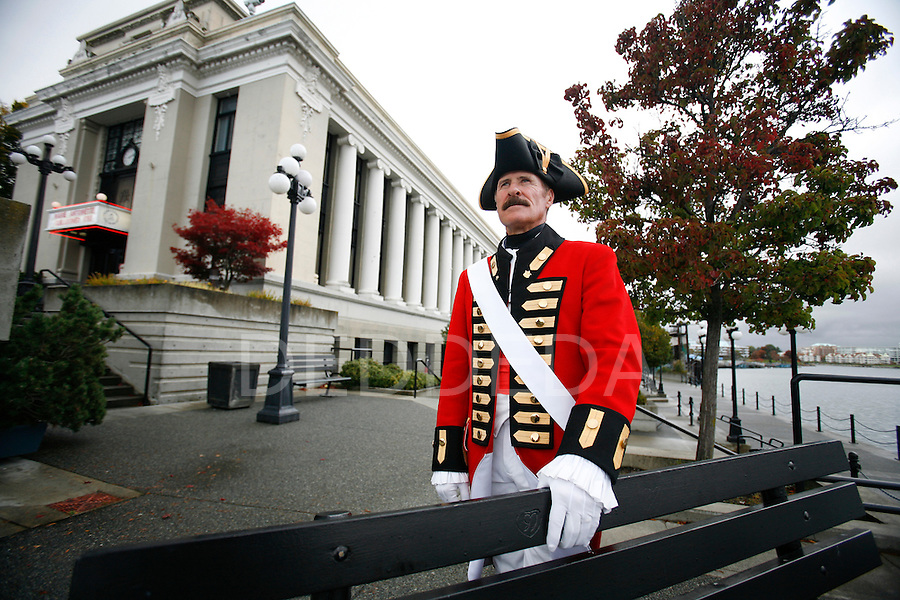 Dressed in full 18th century costume, George Forest, also known as Captain Vancouver, stands outside the Wax Museum in Victoria, BC, where he has worked for many years. Forest retires on Saturday.