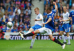 Rangers v St Johnstone....28.08.10  .Liam Caddis is tackled by Lee McCulloch.Picture by Graeme Hart..Copyright Perthshire Picture Agency.Tel: 01738 623350  Mobile: 07990 594431