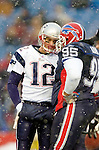 New England Patriots quarterback Tom Brady (12) has a time-out chat with Buffalo Bills defensive tackle Sam Adams (95) at Ralph Wilson Stadium in Orchard Park, NY, on December 11, 2005 . The Patriots defeated the Bills 35-7. Mandatory Photo Credit: Ed Wolfstein