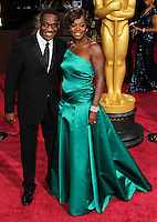 HOLLYWOOD, LOS ANGELES, CA, USA - MARCH 02: Julius Tennon, Viola Davis at the 86th Annual Academy Awards held at Dolby Theatre on March 2, 2014 in Hollywood, Los Angeles, California, United States. (Photo by Xavier Collin/Celebrity Monitor)