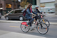 A womman rides a Bixi bike in downtown Montreal Thursday October 25, 2012. Bixi is a public bicycle sharing system developed by the Public Bike System Company (PBSC), which itself was set up by the parking authority of Montreal to create a modular bicycle sharing system for Montreal.