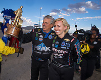Oct 30, 2016; Las Vegas, NV, USA; NHRA funny car driver John Force (left) celebrates with daughter Courtney Force after winning the Toyota Nationals at The Strip at Las Vegas Motor Speedway. Mandatory Credit: Mark J. Rebilas-USA TODAY Sports