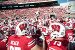 Wisconsin Badgers teammates huddle prior to an NCAA Big Ten Conference football game against the Maryland Terrapins Saturday, October 21, 2017, in Madison, Wis. The Badgers won 38-13. (Photo by David Stluka)