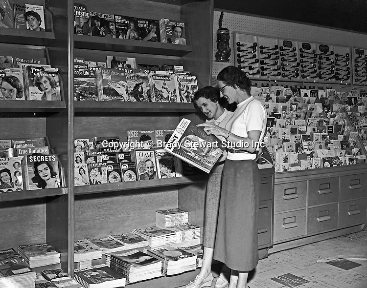 Pittsburgh PA:  On Location photography for Curtis Publications, publisher of the Saturday Evening Post. Magazine section of a local Pittsburgh area Sun Drug Store - 1954