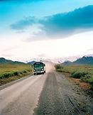 USA, Alaska, a tour bus drives through Denali National Park