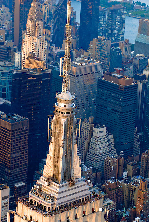 Aerial view of the top tower of the Empire State Building in midtown Manhattan, New York City.