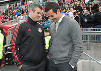 Toronto, Ontario - May 17, 2014: Toronto FC head coach Ryan Nelsen talks with New York Red Bulls head coach Mike Petke before a game between the New York Red Bulls and Toronto FC at BMO Field. Toronto FC won 2-0.