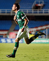 CALI - COLOMBIA -10-04-2014: Rafael Borre, jugador de Deportivo Cali celebra el gol anotado a Deportes Tolima durante  partido Deportivo Cali y Deportes Tolima por la fecha 16 por la Liga Postobon I 2014 en el estadio Pascual Guerrero de la ciudad de Cali. / Rafael Borre player of Deportivo Cali celebrates a scored goal to Deportes Tolima during a match between Deportivo Cali and Deportes Tolima for the date 16th of the Liga Postobon I 2014 at the Pascual Guerrero stadium in Cali city. Photo: VizzorImage / Juan C Quintero / Str.