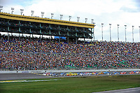 Polesitter Kevin Harvick (#29) leads the field across the starting line.