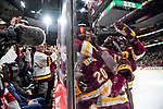 ST PAUL, MN - APRIL 7: Teammates congratulate Karson Kuhlman #20 of the Minnesota-Duluth Bulldogs after his goal past Cale Morris #32 of the Notre Dame Fighting Irish during the Division I Men's Ice Hockey Semifinals held at the Xcel Energy Center on April 7, 2018 in St Paul, Minnesota. (Photo by Tim Nwachukwu/NCAA Photos via Getty Images)