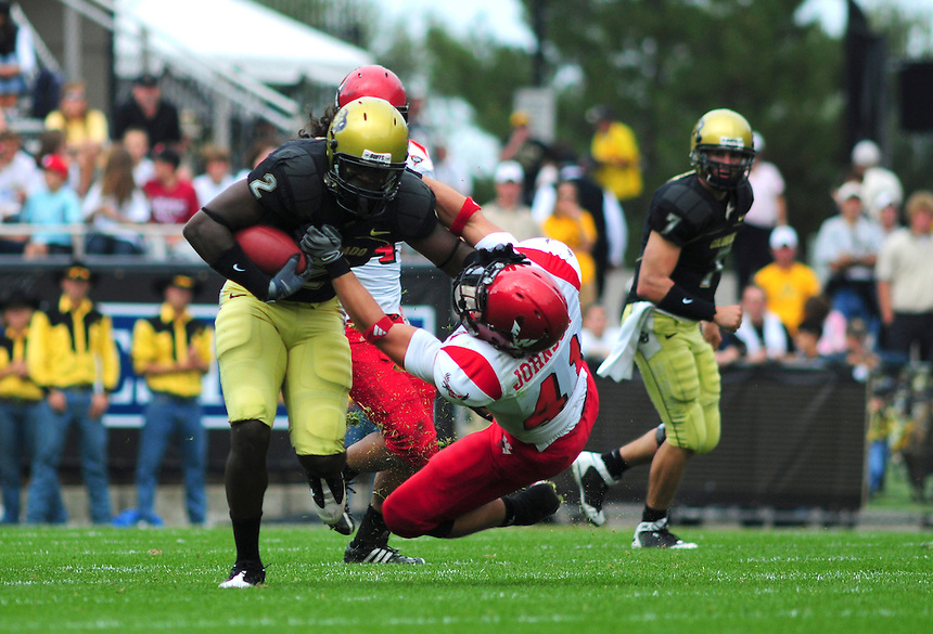 06 September 08: Colorado tailback Darrell Scott (2) gives a stiff-arm to Eastern Washington linebacker Zach Johnson(41). The Colorado Buffaloes defeated the Eastern Washington Eagles 31-24 at Folsom Field in Boulder, Colorado. FOR EDITORIAL USE ONLY