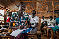 Secondary students attend Kwai Bong's mathematics class in an emergency school in the UN Protection of Civilians camp for internally displaced people in Juba, South Sudan. More than 24,000 people live in the POC on the United Nations compound.
