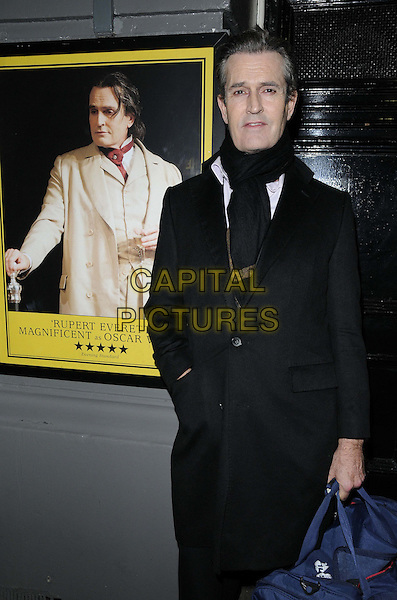"Rupert Everett.departed after the press night performance of ""The Judas Kiss"", Duke of York's Theatre, St Martin's Lane, London, England..January 22nd, 2013.half length black coat scarf hand in pocket blue bag.CAP/CAN.©Can Nguyen/Capital Pictures."