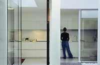 The kitchen has sliding glass doors that open on to the inner courtyard