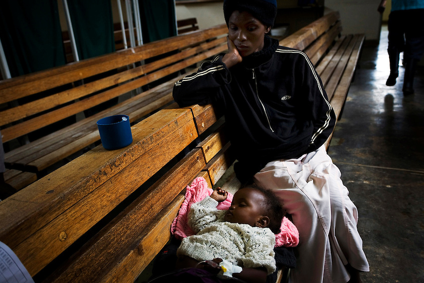 A Zimbabwean child infected with cholera rehydrates through an IV at the Budiriro Polyclinic which is being used as a Cholera Treatment Clinic in Budiriro, Zimbabwe, Friday, December 19, 2008.