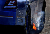 Nov. 15, 2008; Homestead, FL, USA; Flames come from the exhaust of the car driven by NASCAR Sprint Cup Series driver Kurt Busch during practice for the Ford 400 at Homestead Miami Speedway. Mandatory Credit: Mark J. Rebilas-