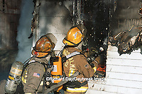 63818-01416 Firefighters extinguishing house fire  Kinmundy-Alma Fire District,  Kinmundy IL