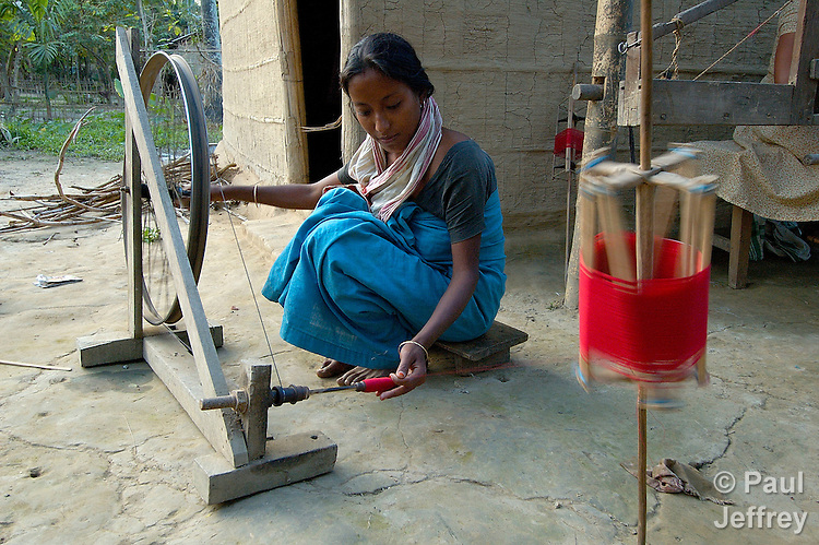 A woman spinning in an Indian village