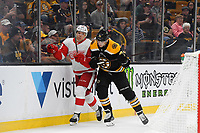 September 26, 2018: Boston Bruins left wing Jake DeBrusk (74) checks Detroit Red Wings defenseman Vili Saarijarvi (29) during the NHL pre-season game between the Detroit Red Wings and the Boston Bruins held at TD Garden, in Boston, Mass. Detroit defeats Boston 3-2 in overtime. Eric Canha/CSM