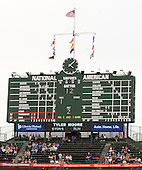 View of the iconic, hand-operated scoreboard at Wrigley Field during the third inning of the game between the Washington Nationals and the Chicago Cubs on Thursday, <br /> Credit: Ron Sachs / CNP
