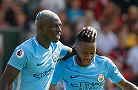 Benjamin Mendy (left) congratulates goalscorer Raheem Sterling of Manchester City on his winning goal during the Premier League match between Bournemouth and Manchester City at the Goldsands Stadium, Bournemouth, England on 26 August 2017. Photo by Andy Rowland.