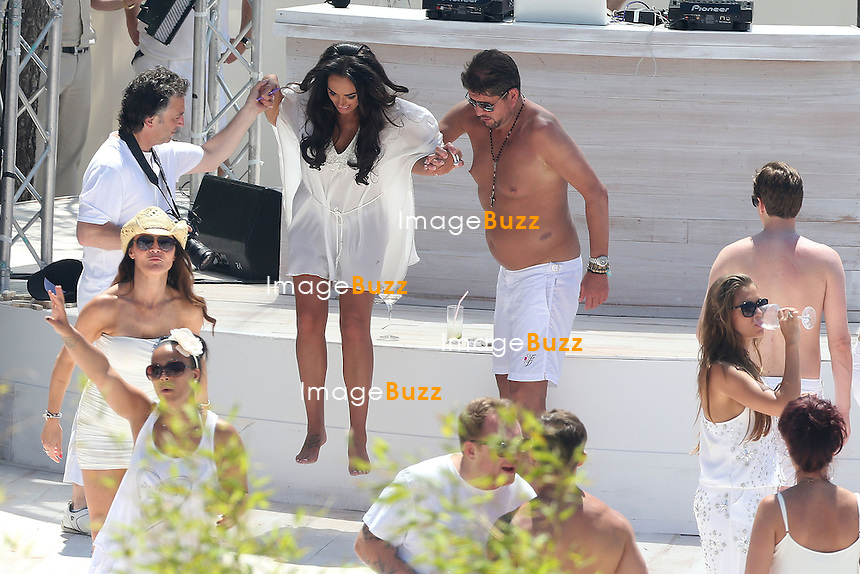 """TAMARA ECCLESTONE & JAY RUTLAND WEDDING IN FRANCE - June 12, 2013-Tamara Ecclestone and Jay Rutland Wedding love story on the beach. Tamara Ecclestone and her husband Jay Rutland are celebrating after their wedding on the beach of """" fair """" in Saint Jean Cap Ferrat. with friends with Nicolas Roberts and Lizzie Cundy."""