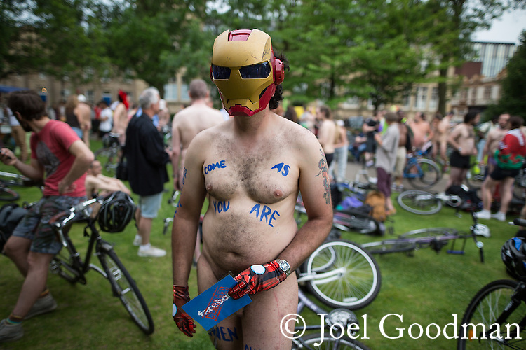 © Joel Goodman - 07973 332324 .  12/06/2015. Manchester, UK. Man wearing Ironman mask . Hundreds take part in the World Naked Bike Ride , which sees cyclists undress and cycle nude through Manchester City Centre . Photo credit : Joel Goodman