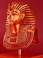 Egypt:  Gold Mask--gold with gems.  Treasures of Tutankhamun, Cairo Museum.  MMA 1976.